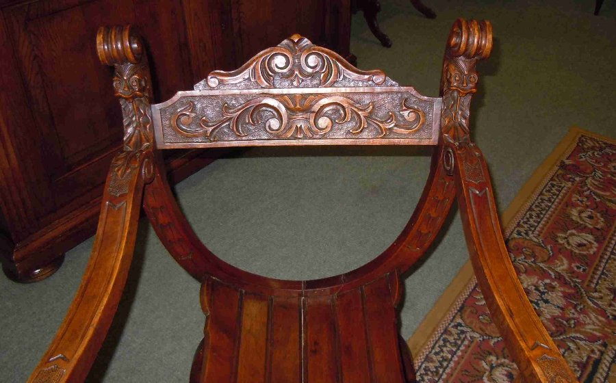 Antique Carved armchair in solid oak called