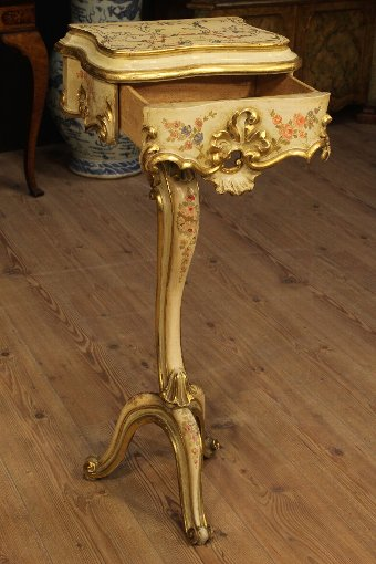 Antique Venetian low table in lacquered, gilded and painted wood of the 20th century