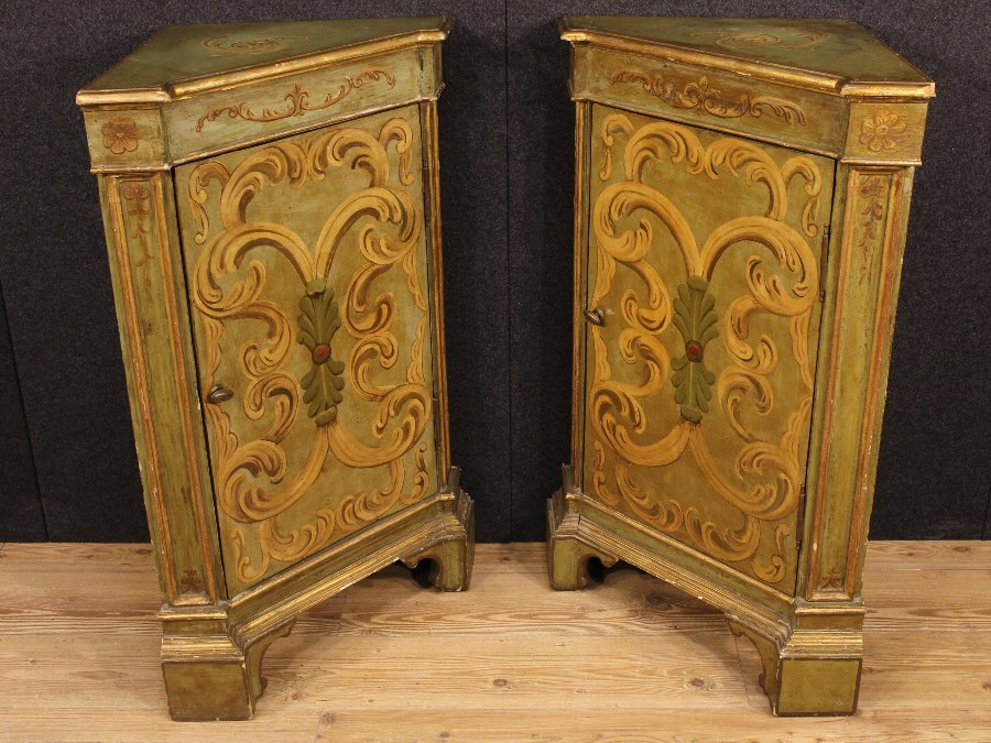 Antique Pair of lacquered and gilded Lombard corner cupboards of the 20th century