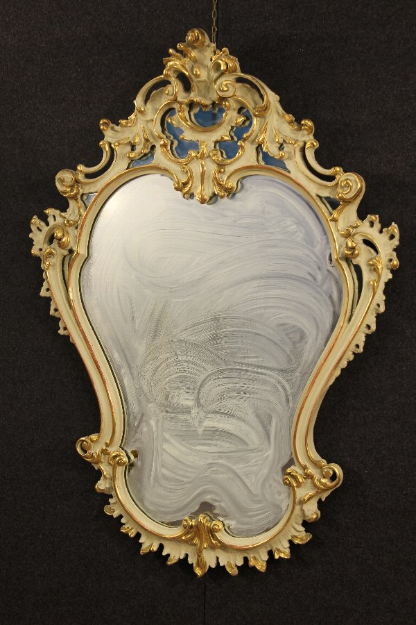 Antique Venetian lacquered and gilded mirror of the 20th century