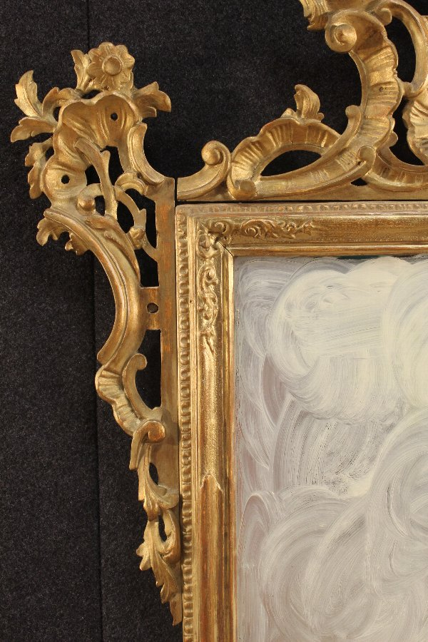Antique Venetian gilt mirror of the 20th century