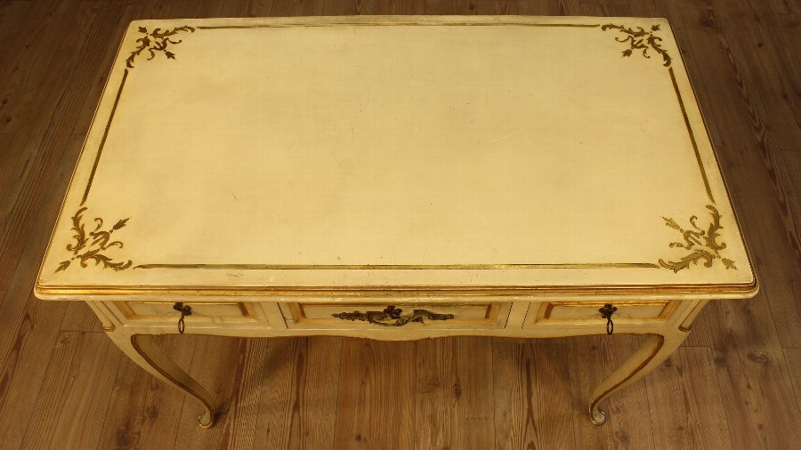 Antique French lacquered and gilded writing desk of the 20th century
