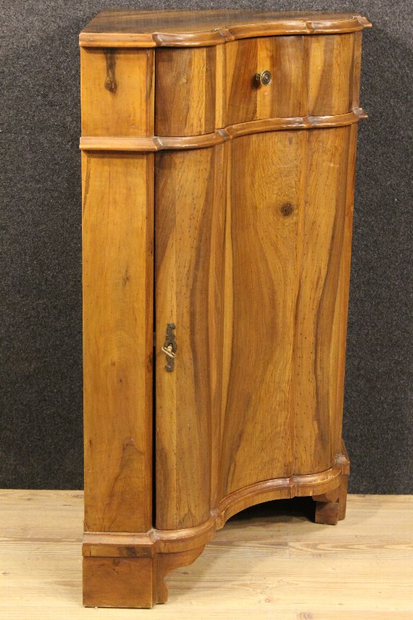 Antique Italian corner cupboard made by walnut of the 20th century