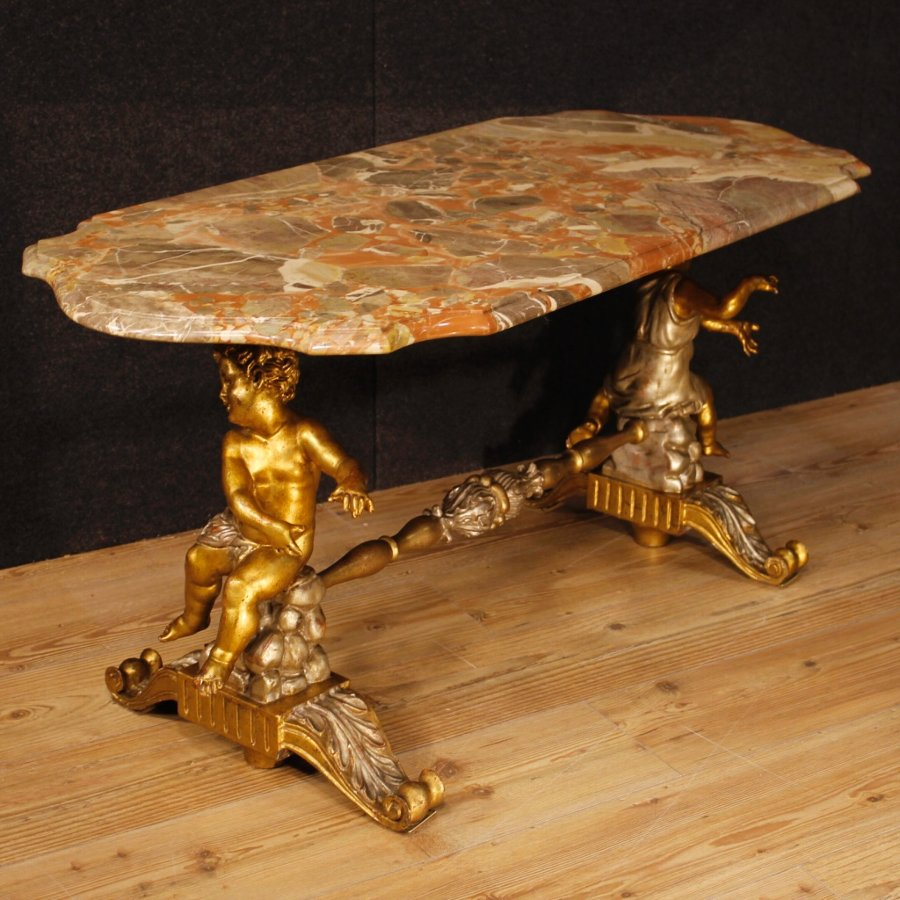 Antique Italian coffee table with marble top and little angels sculptures