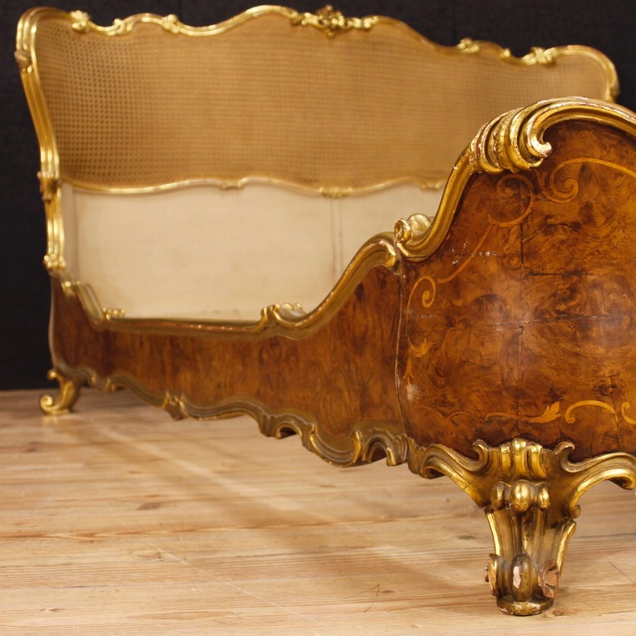 Antique Italian bed in golden and inlaid wood