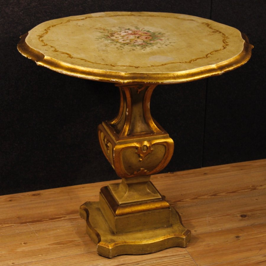 Italian lacquered, golden and painted side table with floral decorations