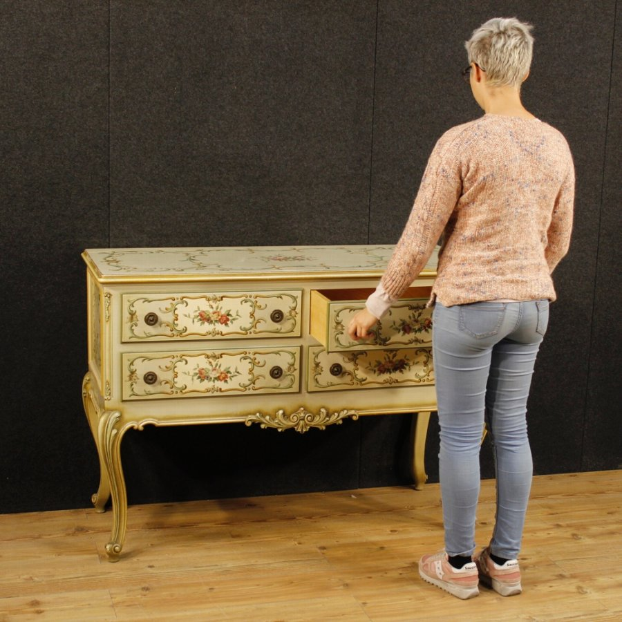 Antique Italian lacquered, golden and painted chest of drawers with floral decorations