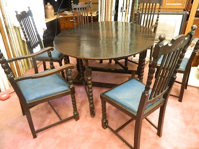magnificent set of jacobean/ gothic dark oak dining chairs and table