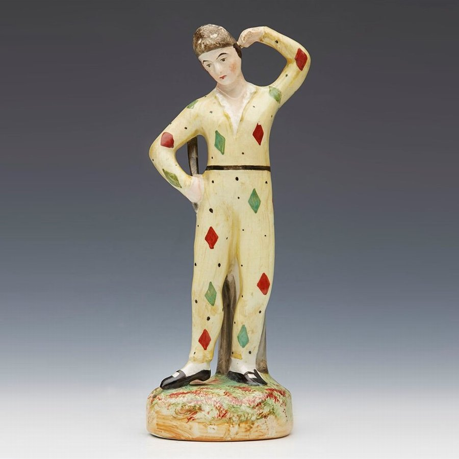Rare 19th century Staffordshire pottery figure of a Harlequin attributed to Thomas Parr