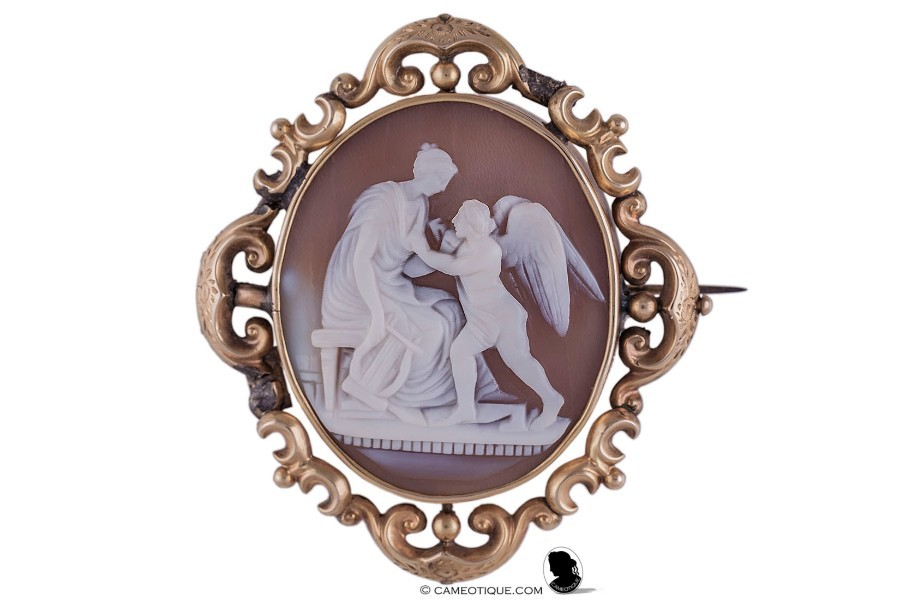 Victorian Sardonyx shell Venus and Cupid mourning compartment cameo brooch, set in an ornate gilted mount.  FREE WORLDWIDE SHIPPING