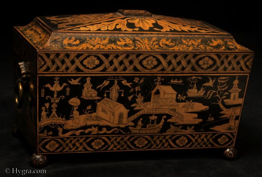 A fine Regency three compartment Penwork Tea caddy decorated all over with exotic penwork scenes on a sycamore ground . Circa 1815.
