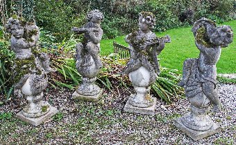 Antique Ornamental garden Statues. Four weathered classical figures of Putti on Ball Finials