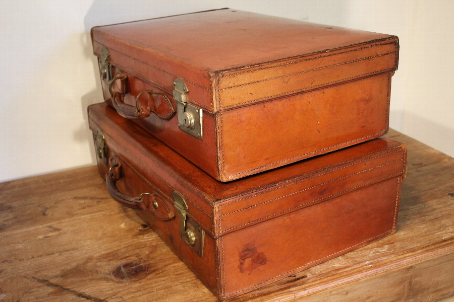 Antique Two matched vintage leather suitcases - Harrods of London