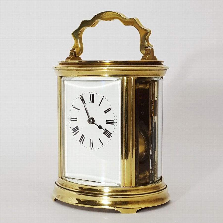 French Oval Brass Striking Carriage Clock c1895