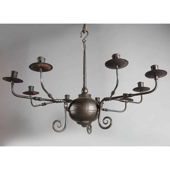 Antique An Arts and Crafts black patinated nine branch Iron chandelier