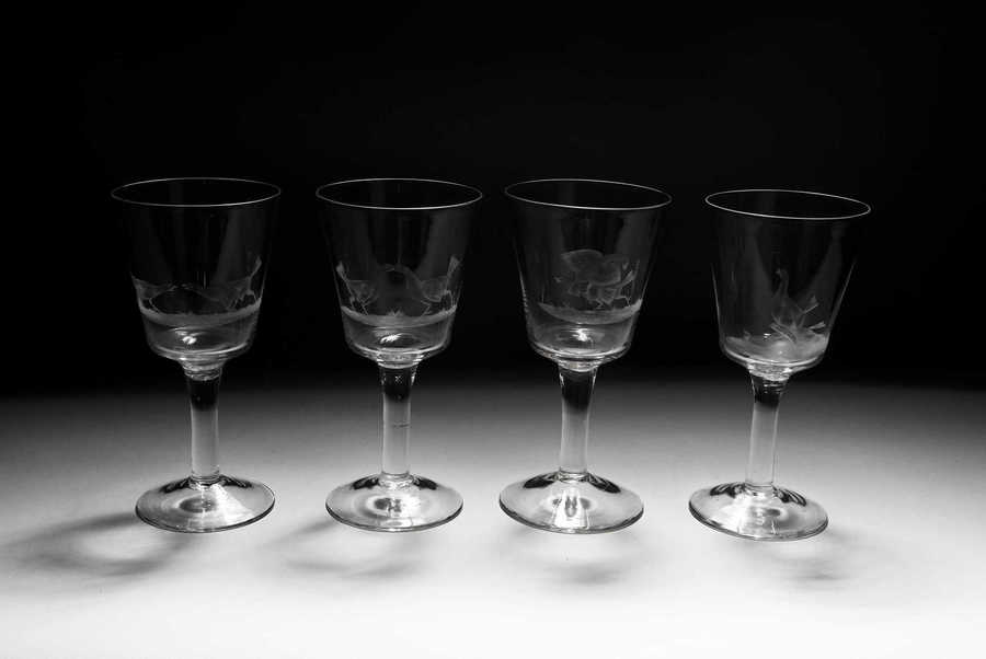 A set of four engraved cock fighting glasses