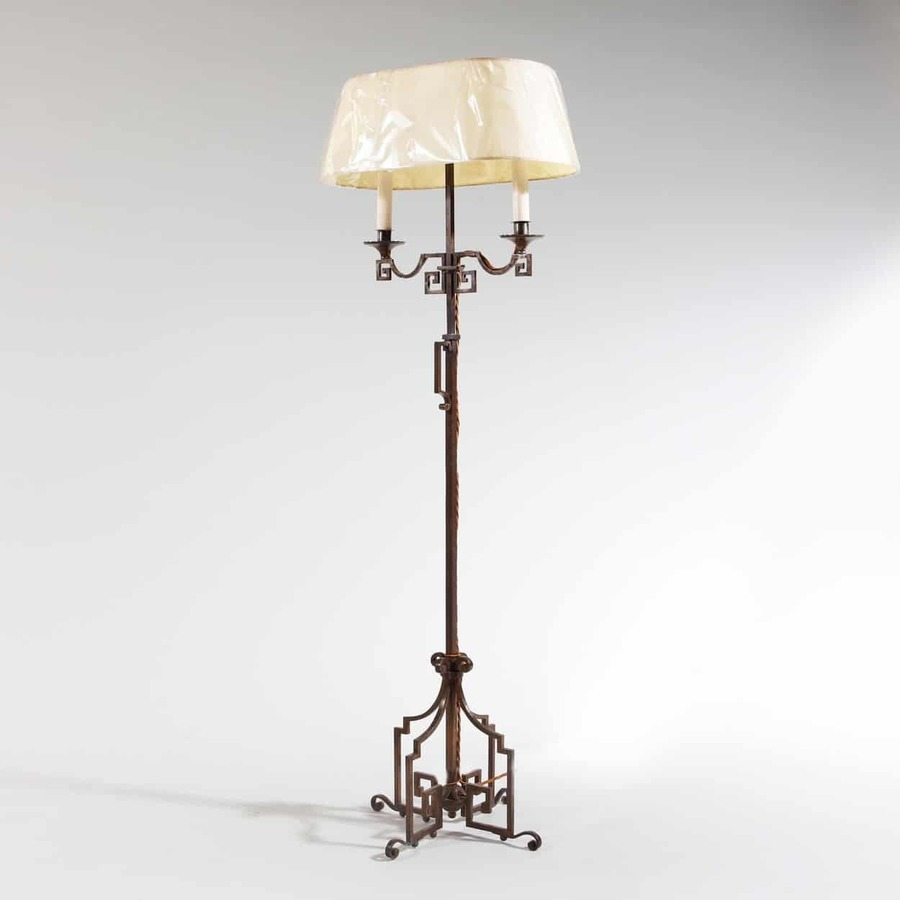 A patinated Steel floor standing bouillotte lamp