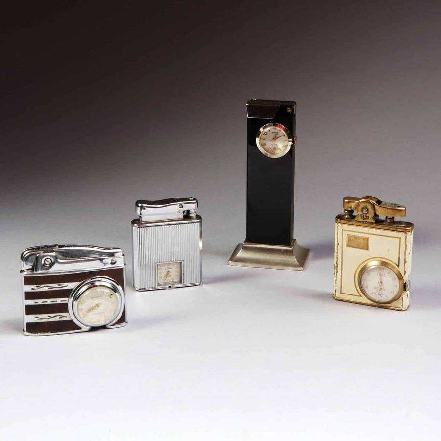 A collection of four mid 20th century watch mounted lighters