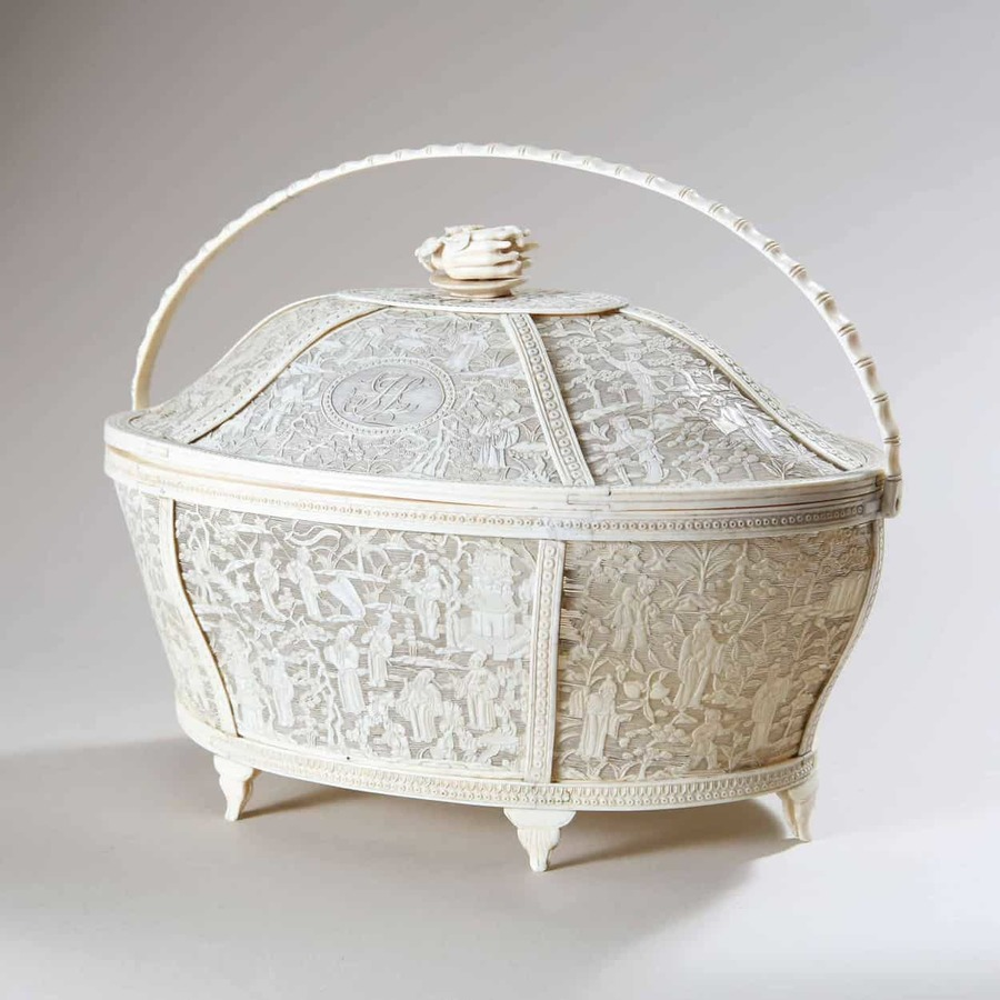 A Chinese Carved Ivory Basket with Floral Finial and Monogram