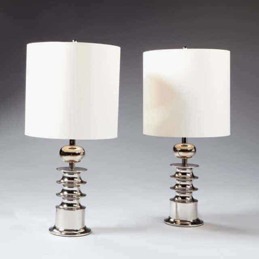A Pair Of Nickel Table Lamps Stamped Ac