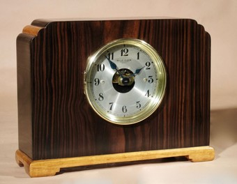 Antique A very stylish Art Deco Bulle Electrical Macassar Ebony and Lemon Wood Mantel Clock 1928