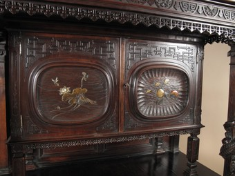 Antique Japonism. Aesthetic movement. A very interesting European walnut cupboard, mounted with Japanese lacquered panels.