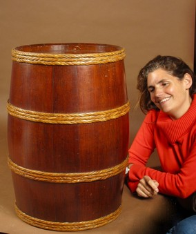A Very Nice And large Coopered Campaign/Ships Teak Barrel With Woven Cane Bindings.