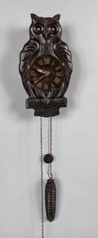 Antique  A very decorative and original moving eyes Black Forest Owl wall clock.