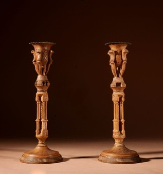 Antique A pair of very stylish unusual very fine carved and engraved walnut candlesticks.