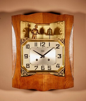 A French Oak Signed Odo Automaton Striking Wall Clock.