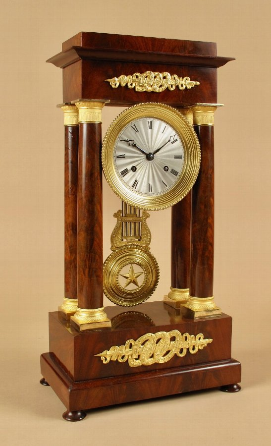 A Finely Made Louis Philippe Mahogany and Ormolu Portico Clock Circa: 1830-1837