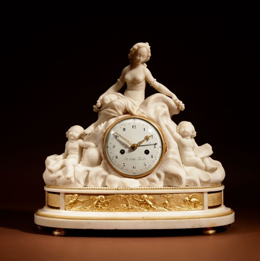 A French Large White Marble And Ormolu Pendule Mantel Clock With The Allegory of Love and Science.