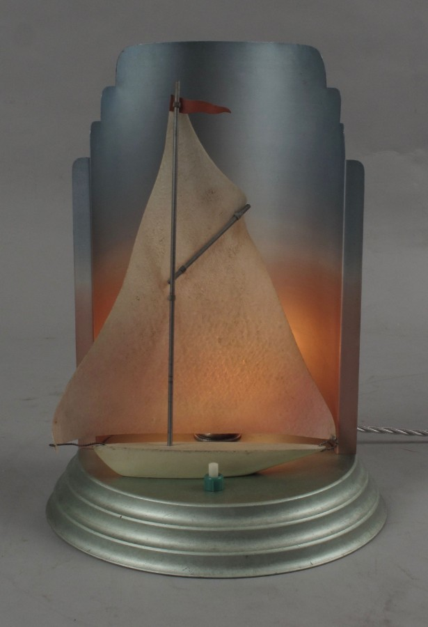 A very rare and decorative original Art Deco table lamp, still with the original lustre spray pai...