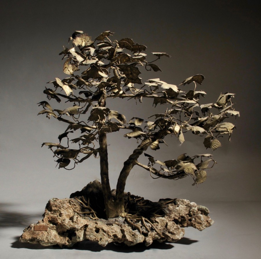 Bronze Bonsai, A very decorative and beautiful made miniature tree, standing on a natural rock (p...