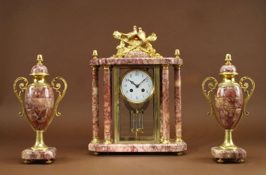 A Very Decorative French Gilded Brass And Marble Clock Garniture, circa 1900