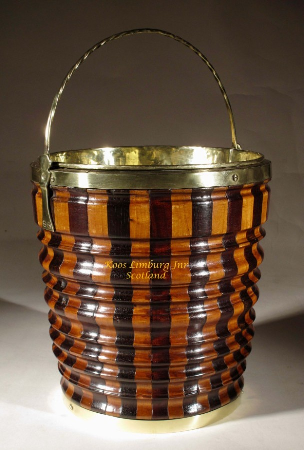 A very decorative Dutch original coopered peat tea bucket jardinière tea stove made with different kinds of wood.