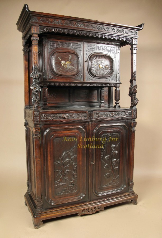 Japonism. Aesthetic movement. A very interesting European walnut cupboard, mounted with Japanese ...