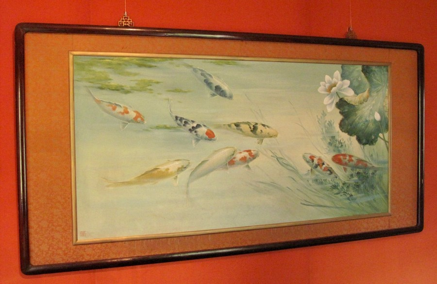 An unusual very decorative oil painting of koi carp, very detailed painted.
