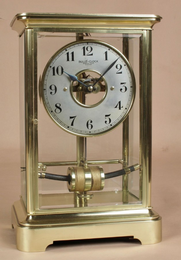 A very decorative original bevelled 4 glass electrical lacquered signed brass Bulle clock.