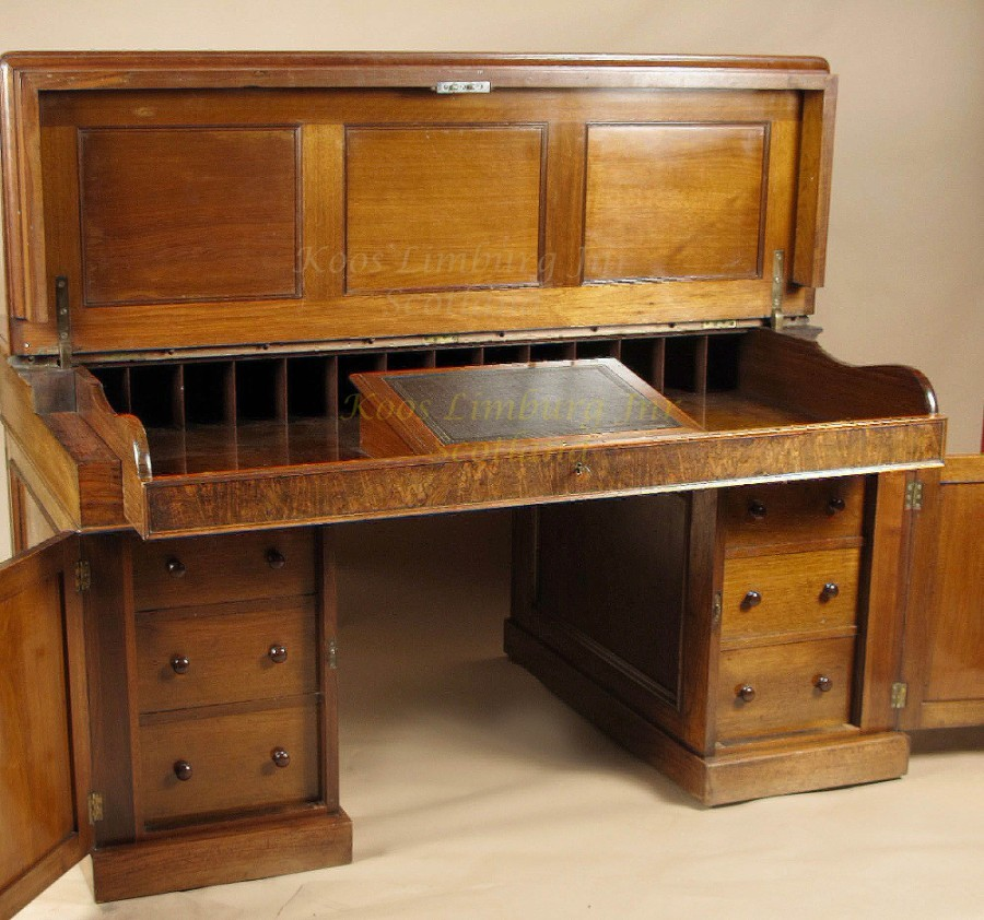 An exceptional and rare mahogany and burr walnut writing/ partner desk.