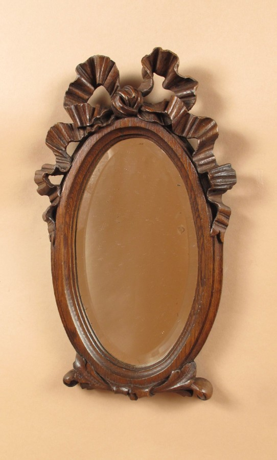 A Decorative Carved Oak Oval Mirror, Louise seize Style, circa 1900
