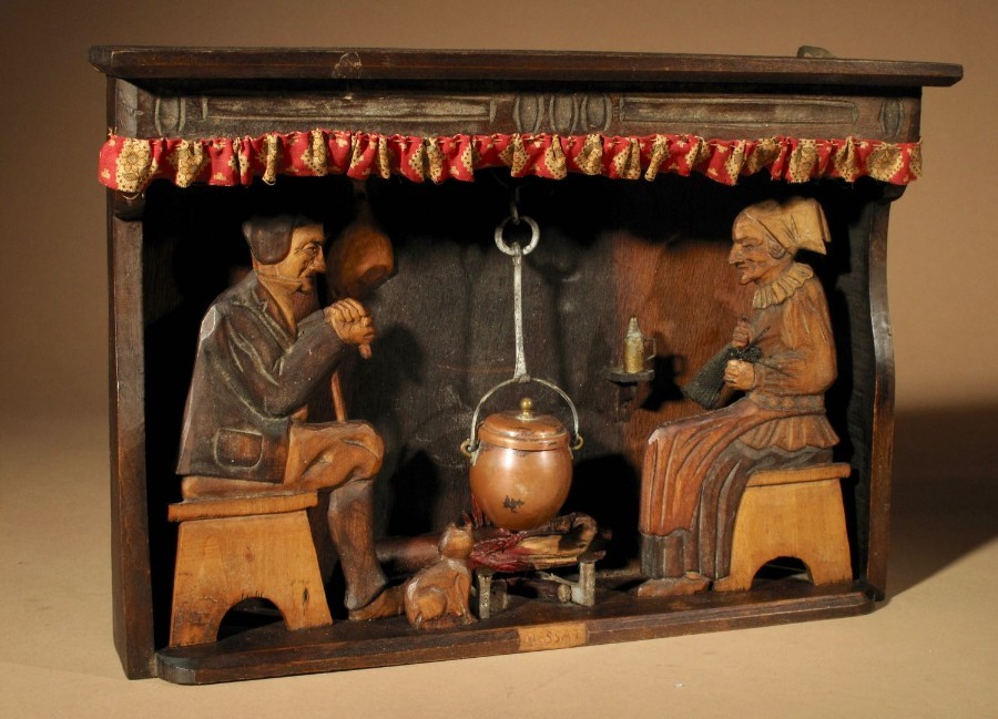 An Amusing Diorama of a Farmer and His Wife Sitting By the Fire,