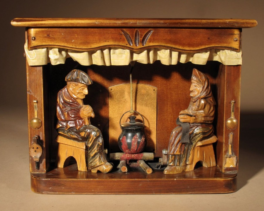 An Amusing Diorama of a Farmer and His Wife Sitting By the Fire, c. 1920-1940
