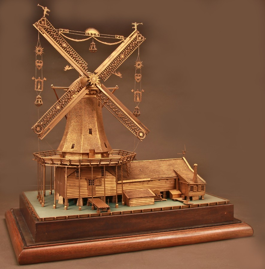 A magnificent very detailed gilded bronze large model of a Dutch windmill. Made by the silver smi...