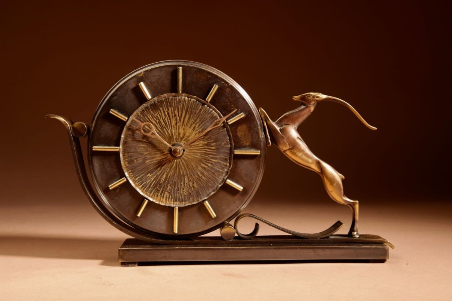 An Art Deco Amsterdam School Patinated Brass/Bronze And Gilded Springbok  Mantel Clock, Circa 193...