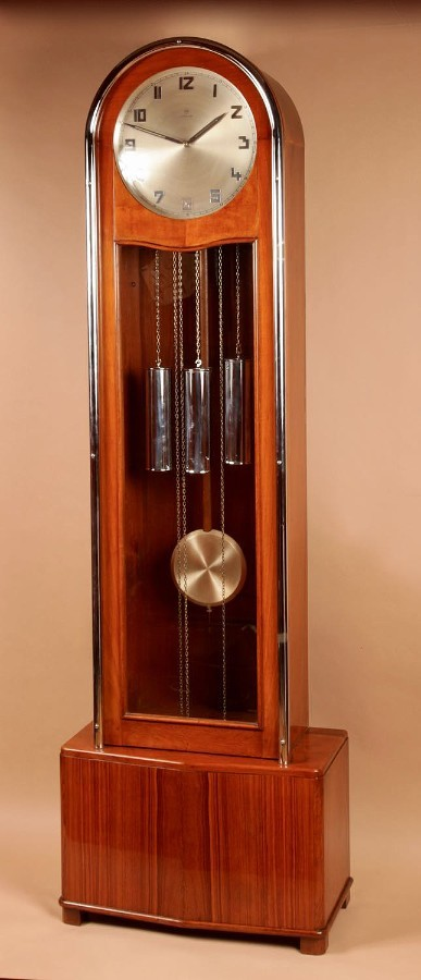 An Art Deco Modernist Junghans Teak/Amaranth And Chrome Very Stylish Westminster Longcase Clock. ...