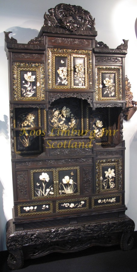 A magnificent Japanese cabinet with 13 panels including the doors, beautifully on laid with deep ...