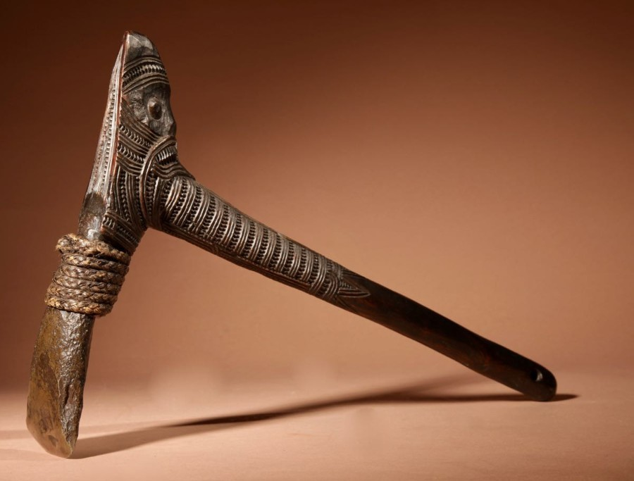 A finely carved wooden MAORI Toki with hard stone (axe). Circa 1900-1920.