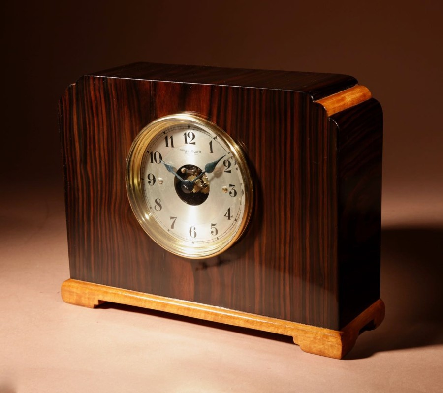 A Very Stylish Art Deco Bulle Electrical Macassar Ebony and Lemon Wood Mantel Clock.
