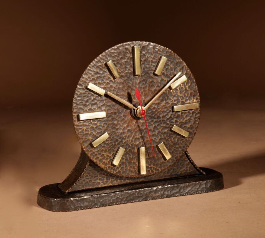 Antique A Very Stylish Amsterdam School Hammered Patinated Brass Early Electrical Mantel Clock.